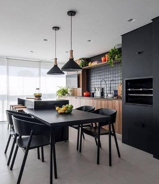 Varanda com churrasqueira em tons de preto