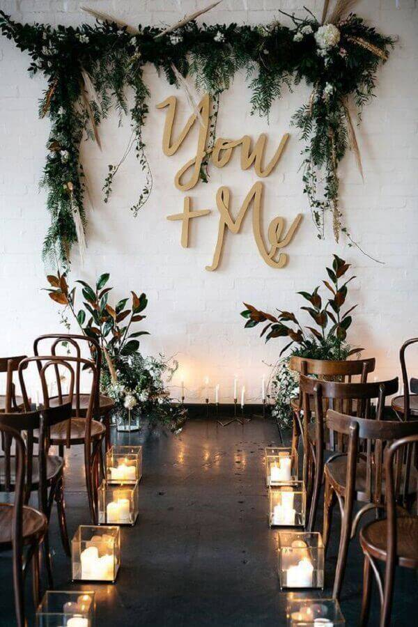 arrangement with foliage and candles for wedding ceremony decoration Photo My Sweet Engagement