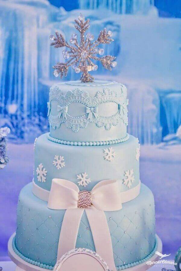 three-storey frozen birthday cake with delicate decoration Photo My Party