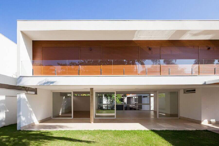 casa com guarda corpo de vidro para sacada Foto Pessoa Arquitetos