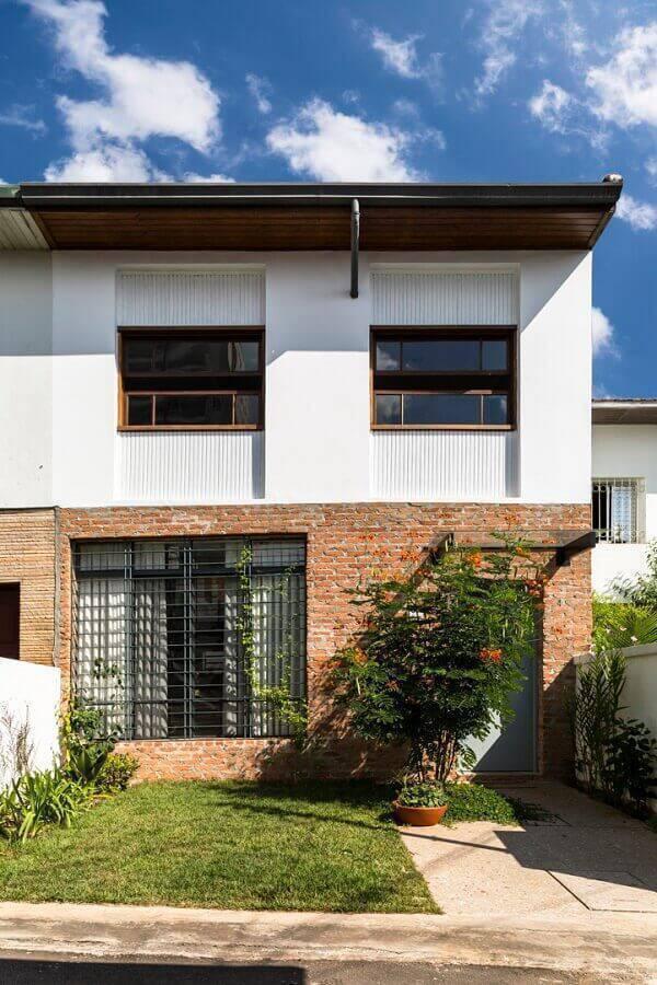 casas lindas com parede de tijolinho a vista Foto DT Estúdio
