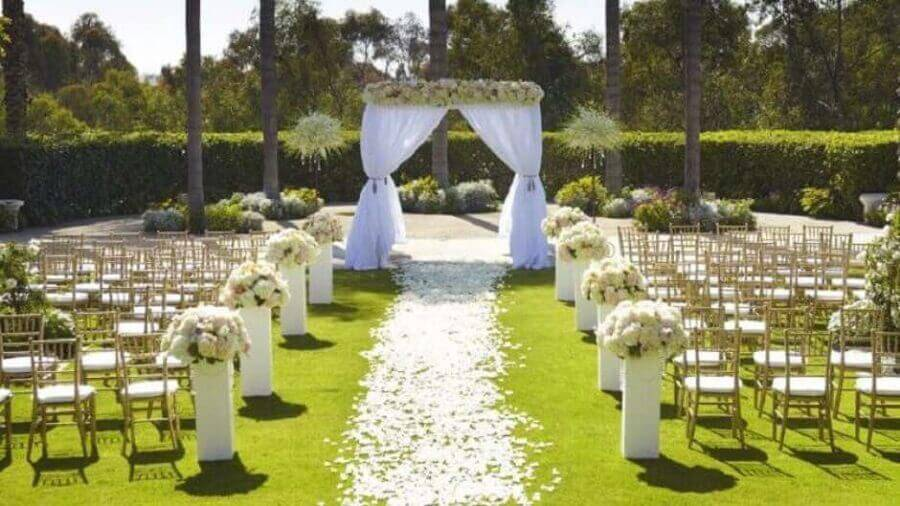 outdoor wedding ceremony decorated with white flower arrangement and rose petal path Photo Why Santa Claus
