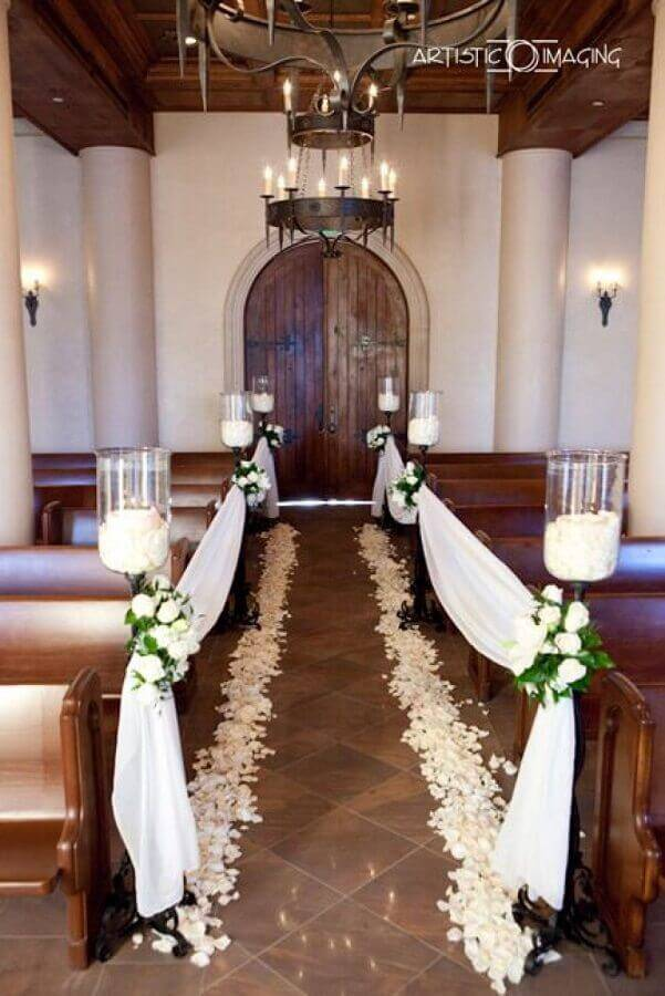 simple wedding ceremony in church with white flower petals Photo Wedding Ideas]
