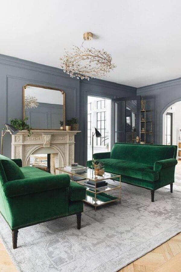 decoração clássica para sala com sofá verde escuro e lareira Foto Ten is Extreme Shop
