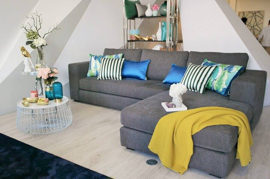 the decor simple, living room with colorful pillows for a sofa, grey