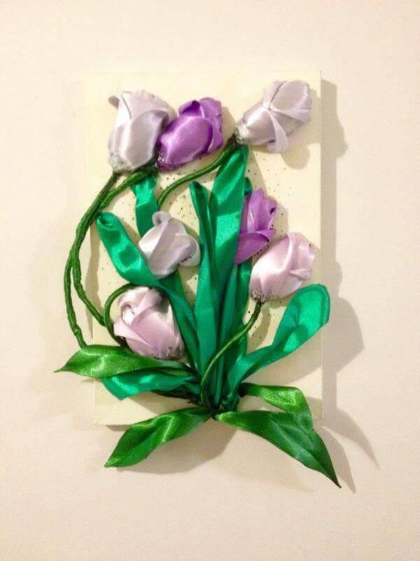 Flor de fita no quadro