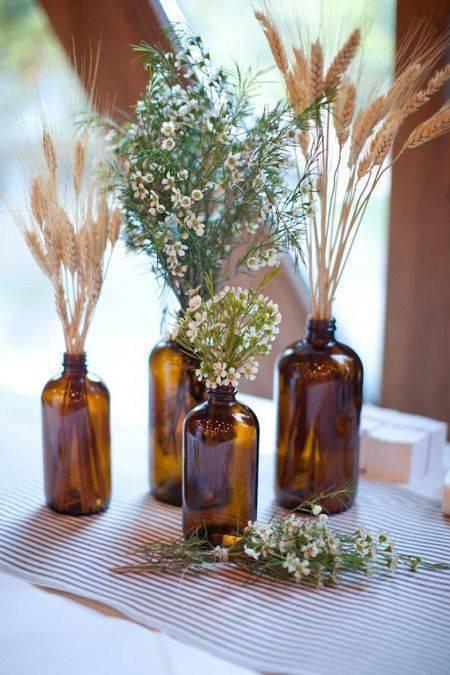 flores secas - garrafas escuras com flores