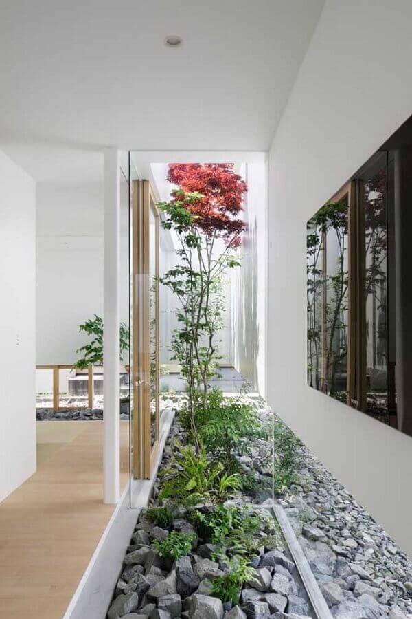 jardim residencial com pedras Foto Archello
