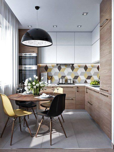 Lustre para cozinha acima da mesa de madeira