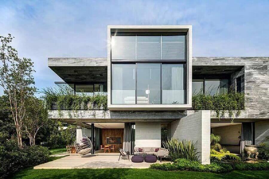 modelos de casas lindas e modernas com amplas paredes de vidro Foto Architizer