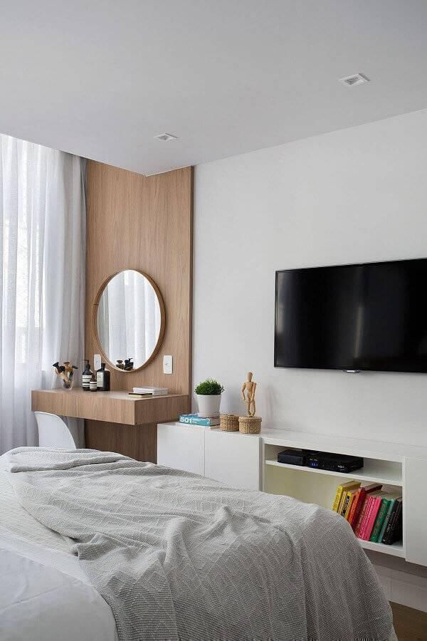 modelos de quarto decorado com penteadeira suspensa e espelho redondo Foto Conexão Decor