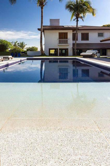 pedra para piscina - piscina com borda infinita grande