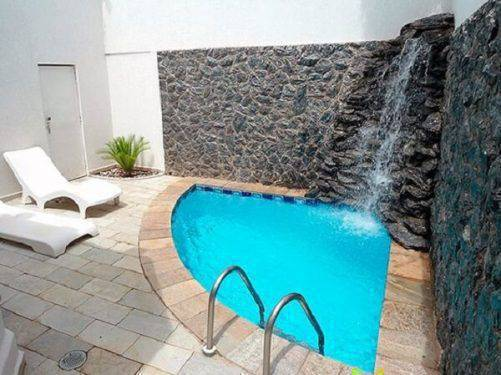 pedra para piscina - piscina com cascata