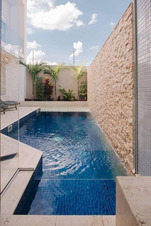 pedra para piscina - piscina com parede de pedra