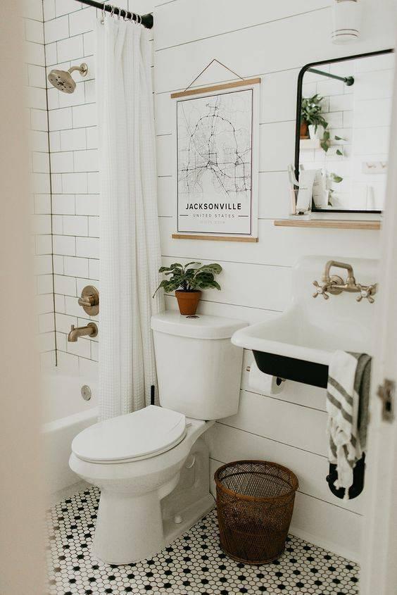pisos antigos - piso preto e branco em banheiro