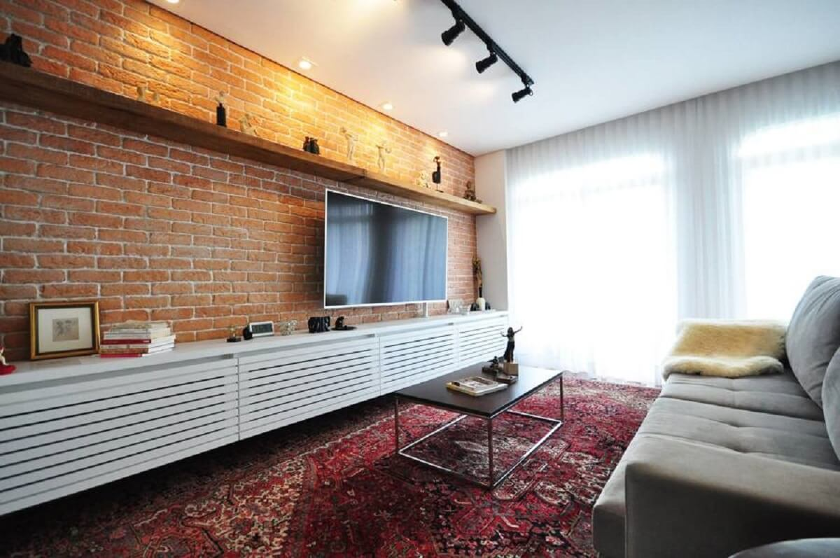 the living room is decorated with a brick wall in sight, and a trail of light