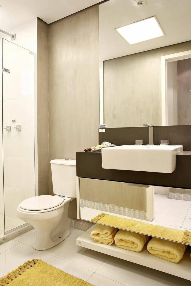 torneira para pia de banheiro - banheiro com toalhas amarelas