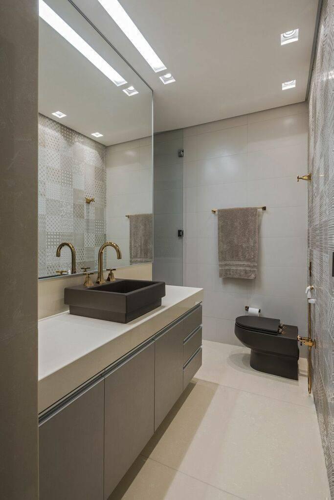torneira para pia de banheiro - parede com ladrilho hidráulico e móveis planejados
