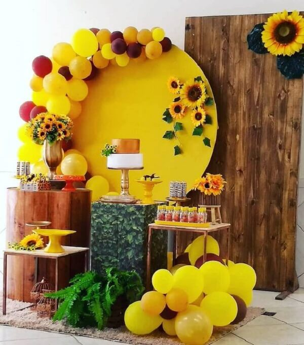 Sunflower theme party decoration with wood panel, fern and bladders