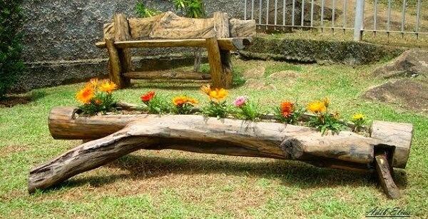 Floreira de madeira feita com tronco serve de abrigo para as Gazâneas