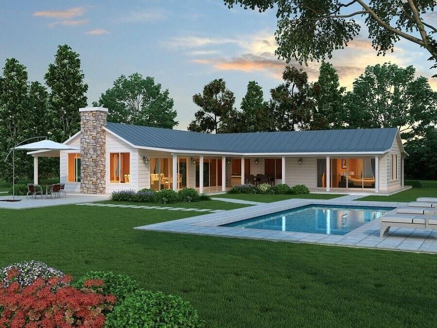 casa em l com piscina Foto ArchDaily