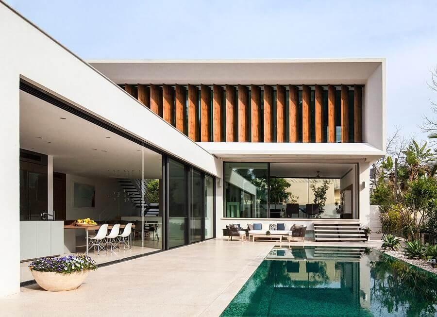 casa em l com piscina e arquitetura moderna Foto Archilovers