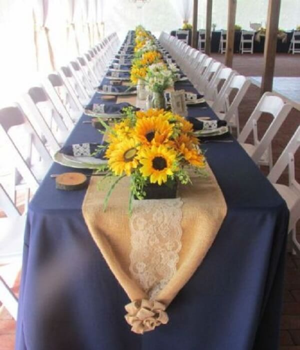 Guest table decorated with flowers for sunflower theme party