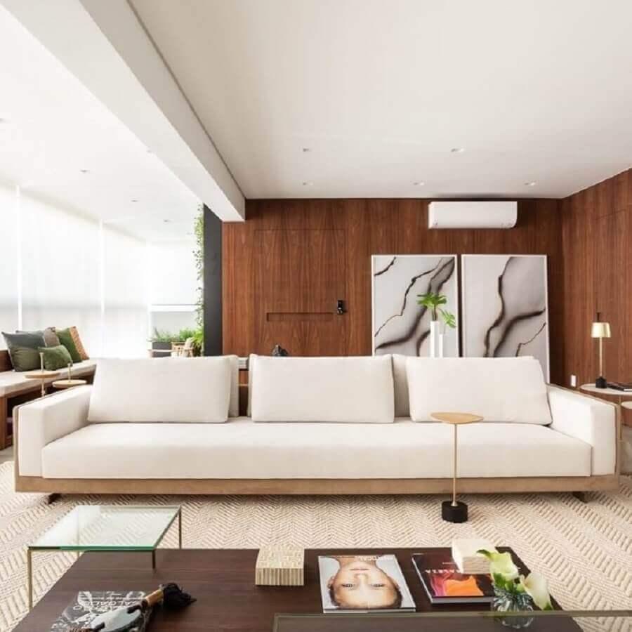 decoração sofisticada para varanda com sofá moderno branco Foto Figueiredo Fischer Arquitetos
