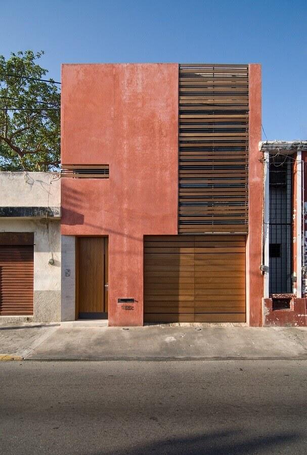 fachada moderna de casa cor terracota Foto ArchDaily