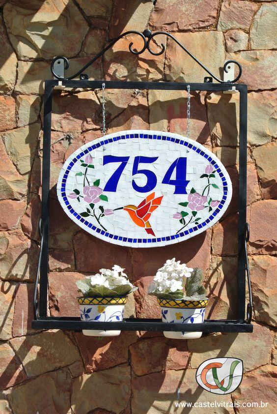 Número de casa com mosaico