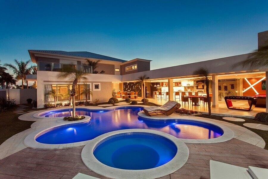 projeto de casa em l com piscina grande Foto Arquiteto Aquiles N. Kílaris