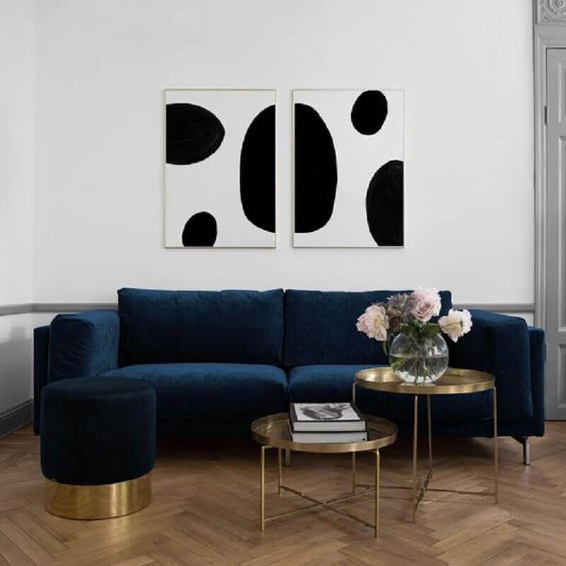 quadros preto e branco para sala com sofá azul Foto Bemz