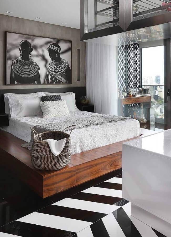 quarto de casal moderno decorado com quadro grande na parede de cimento queimado Foto Your Keyword Basket