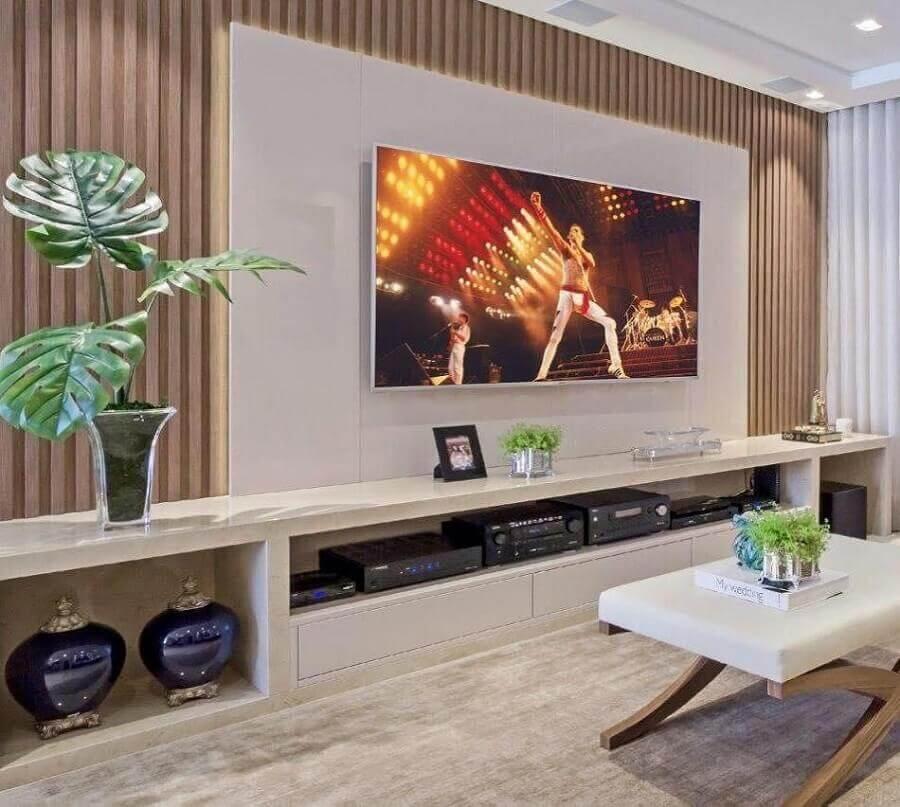 rack com painel branco para sala moderna decorada Foto Pinosy