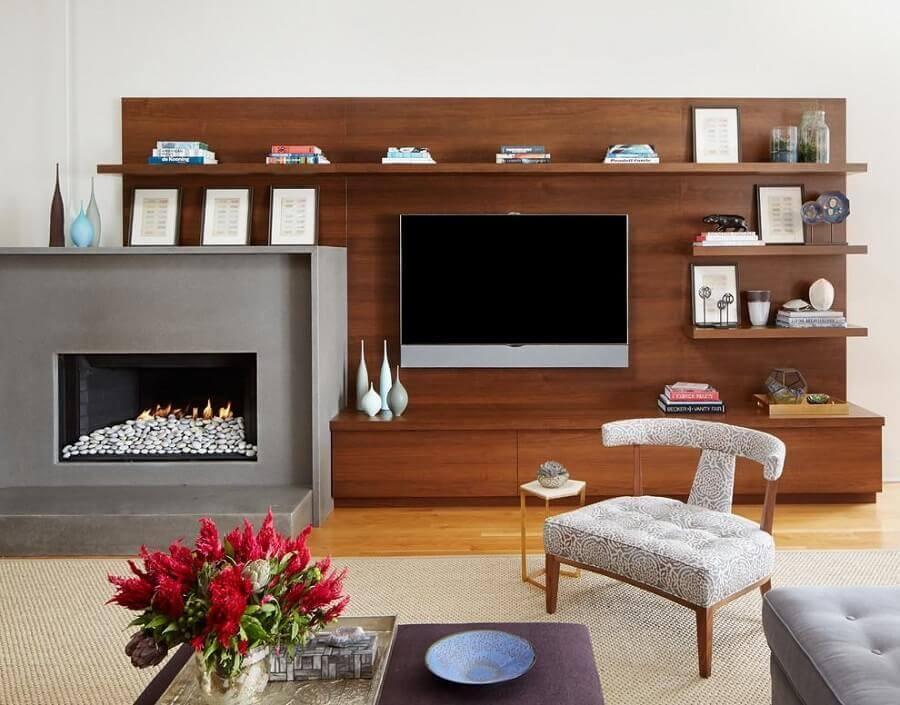 rack com painel para sala moderna com lareira Foto Jessica Lagrange Interiors