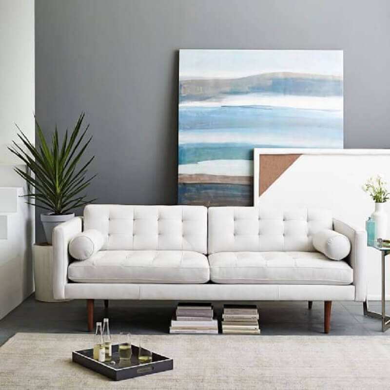 sala moderna decorada com quadros grandes e sofá branco Foto Why Santa Claus