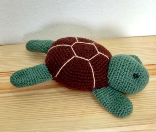 Tartaruga amigurumi para peso de porta