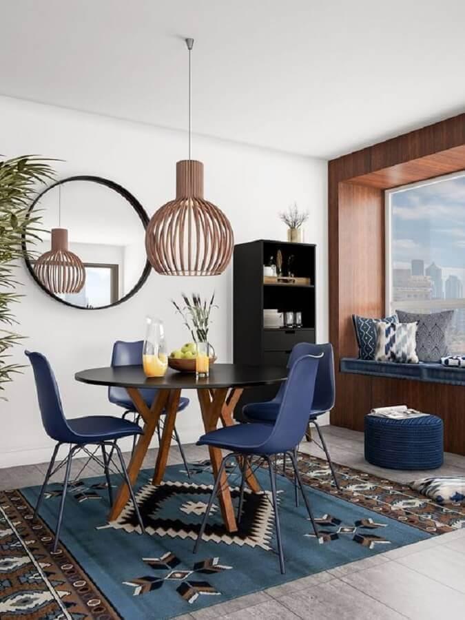 cadeiras para sala de jantar azul com mesa redonda Foto Article