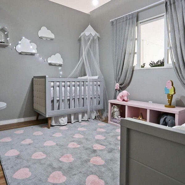 Modelo de tapete cinza e rosa delicado para quarto de bebê