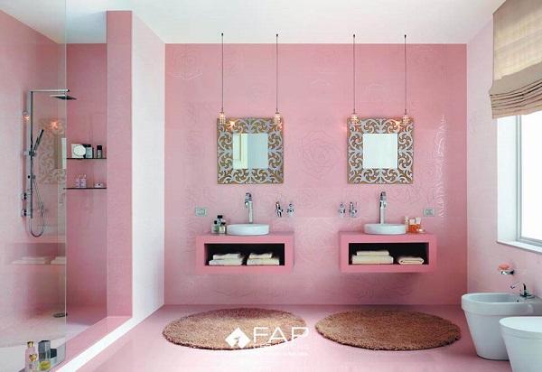 Banheiro rosa com duas pias