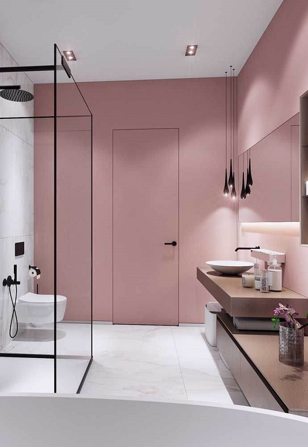 Banheiro rosa com porta rosa e detalhes pretos