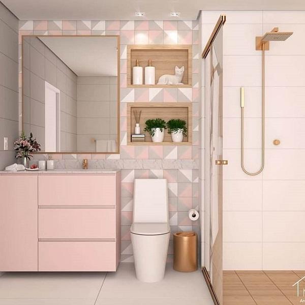 Banheiro rosa e dourado com itens de decoração