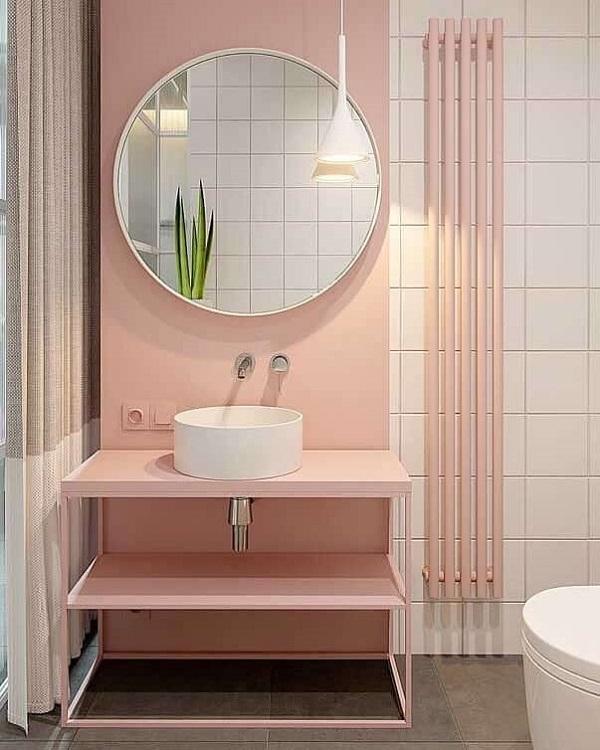 Banheiro rosa espelho redondo e paredes rosa candy