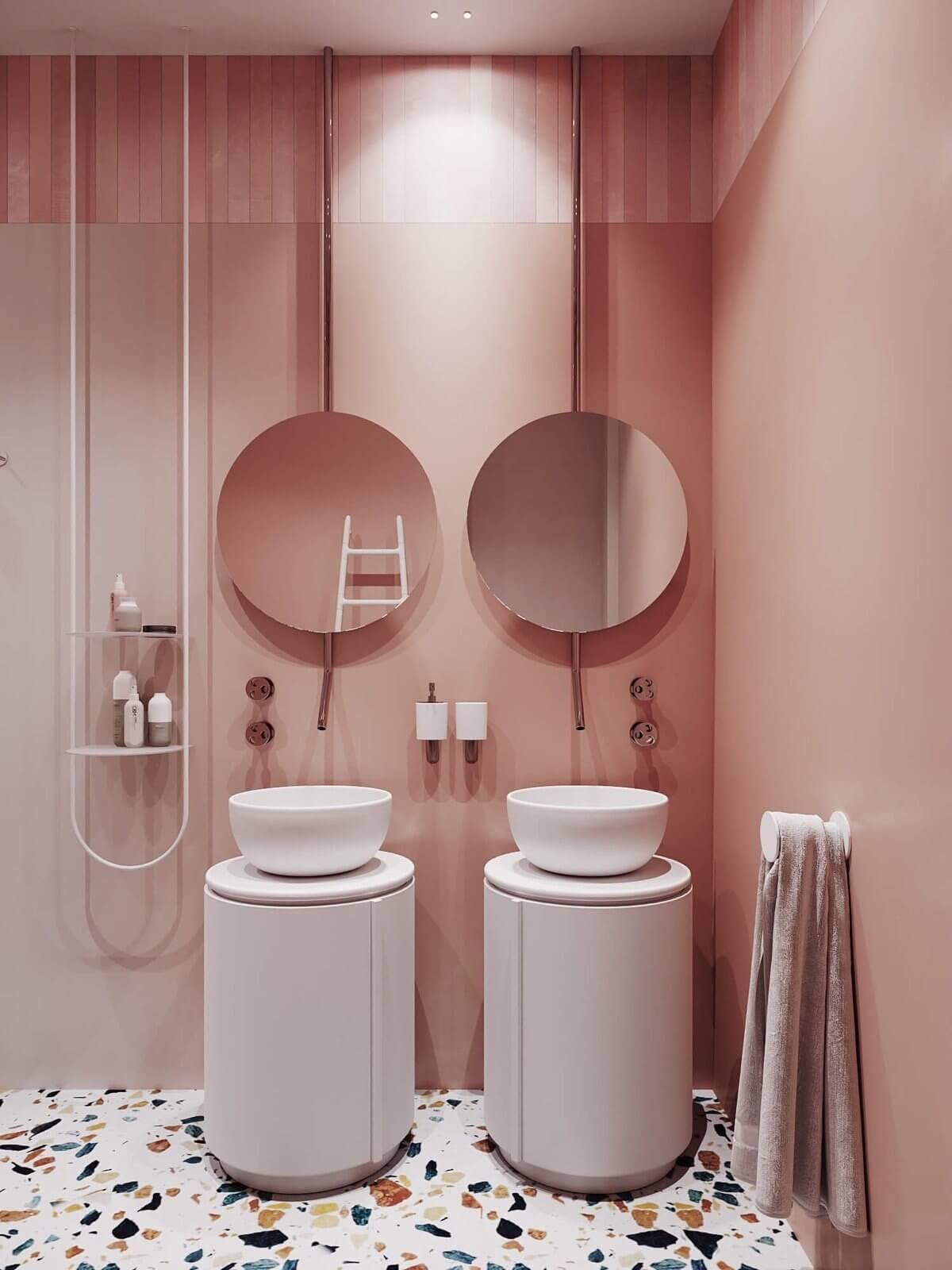 Banheiro rosa espelhos redondos e cubas redondas