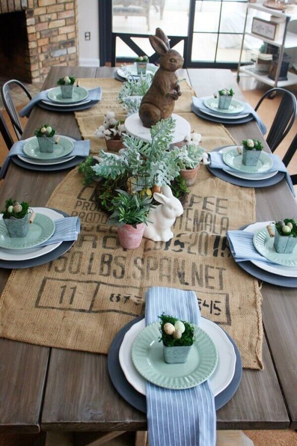 Simple decoration for Easter table with wooden rabbit