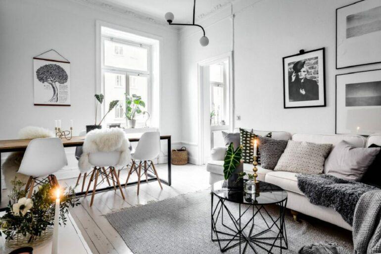 Hygger decora para sala de jantar e de estar integrada com muitas almofadas e tapete cinza – Foto: The Gempicker