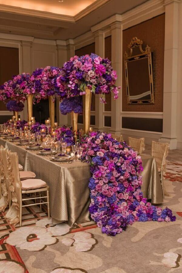 purple flower arrangement for wedding party decoration Photo WedLuxe Magazine