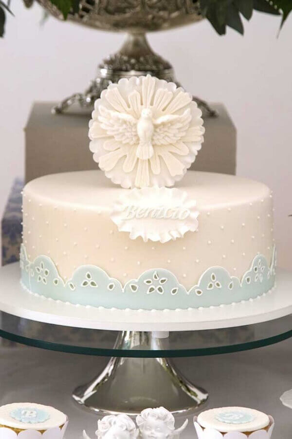 cake with holy spirit on top for decoration of baby christening Photo Dressed as Mother