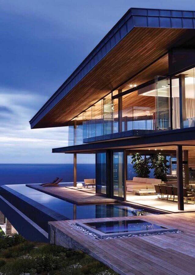 casas de luxo modernas com paredes de vidro Foto Behance