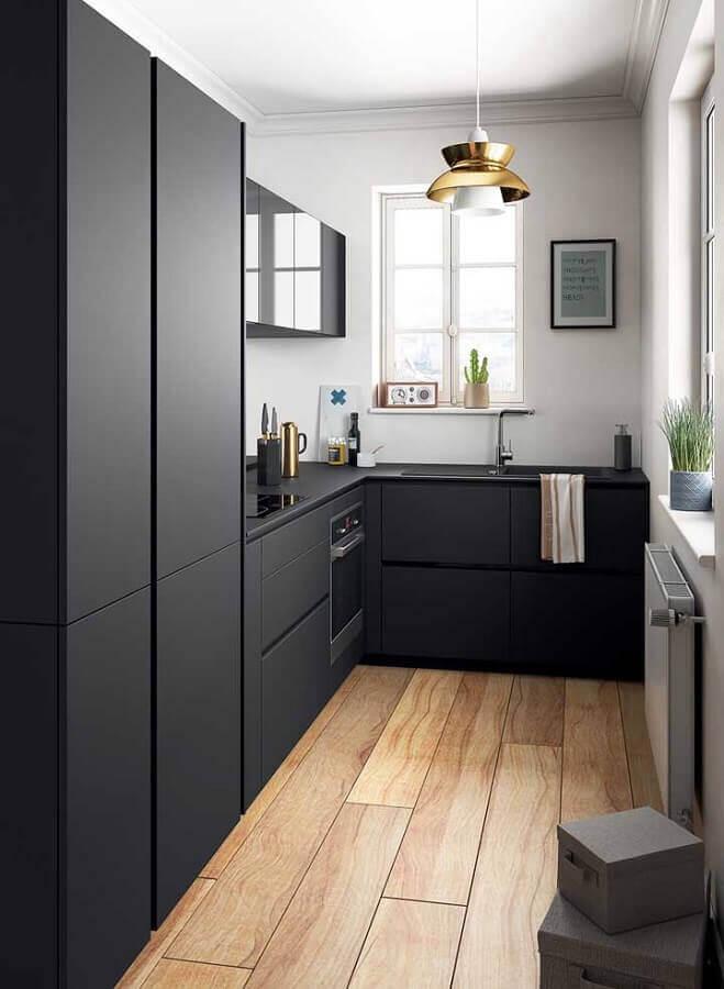 cozinha planejada preta decorada com piso de madeira Foto Casa de Valentina